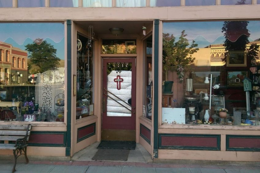 Baker City heritage buildings mirrored in storefront windows