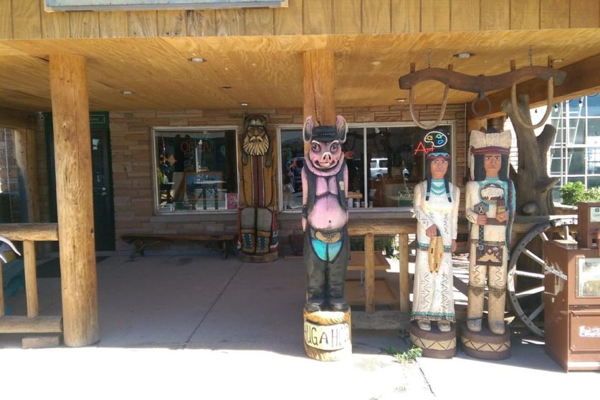 Unique life-size carvings on display in front of shop on Route 66 in Williams