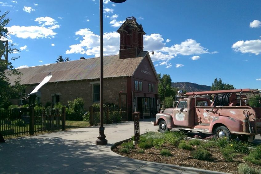Antique fire truck parked outside the old Ridgway Fire Department building